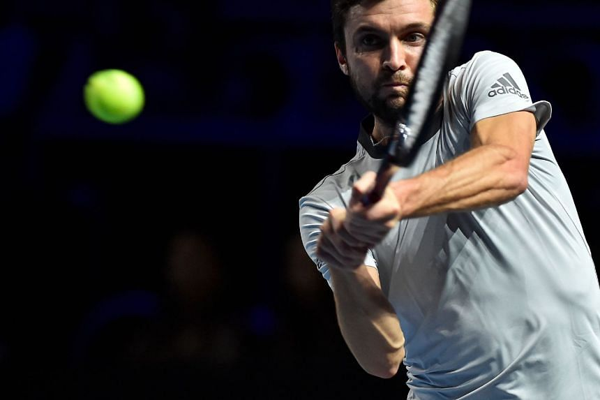 France's Gilles Simon returns the ball to Moldavia's Radu Albot.