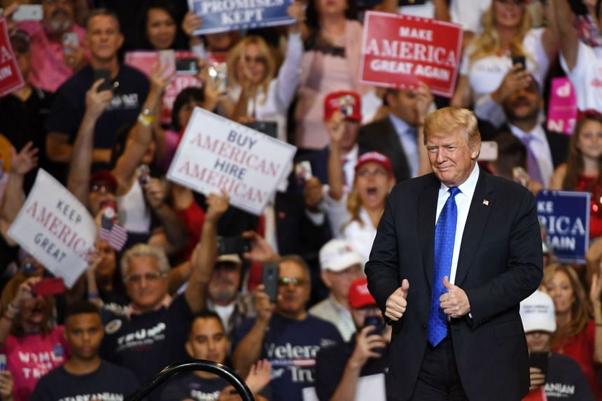 Trump gestures as he walks onstage for a campaign rally on Sept 20, 2018 in Las Vegas, Nevada.