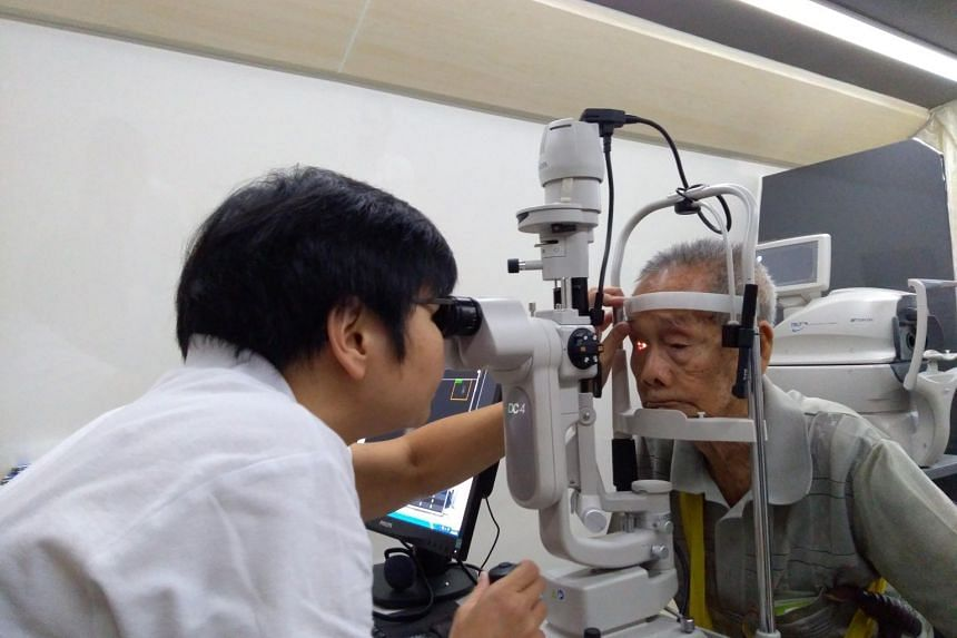 Mr Pang undergoes a slit lamp examination conducted by the Singapore National Eye Centre.