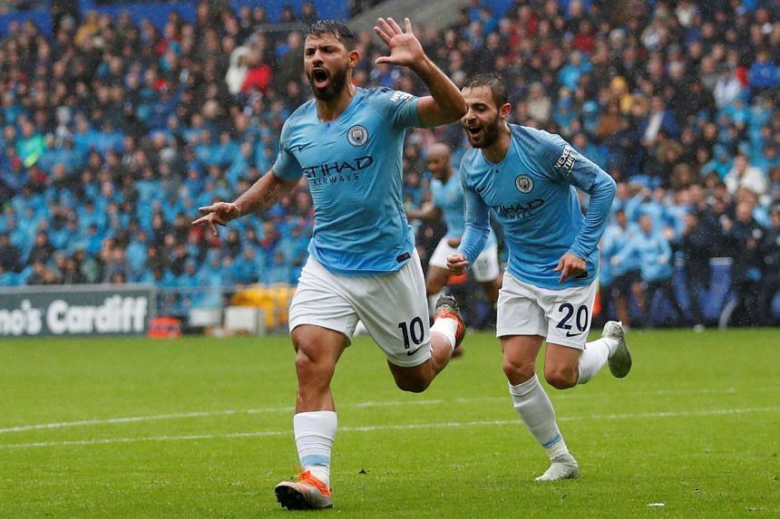 Aguero celebrates scoring City's first goal with Bernardo Silva.