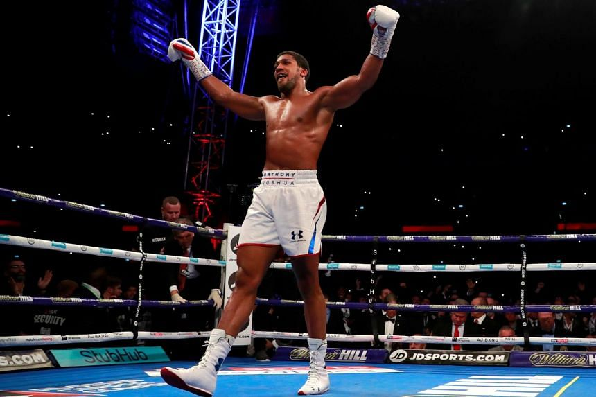 Joshua reacts after knocking down Alexander Povetkin.