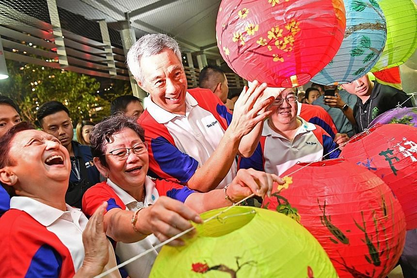 More than 5,000 people attended yesterday's Teck Ghee Lantern Night at Bishan-Ang Mo Kio Park where Prime Minister Lee Hsien Loong joined residents to celebrate the Mid-Autumn Festival, which falls tomorrow. Many penned their thoughts and wishes for