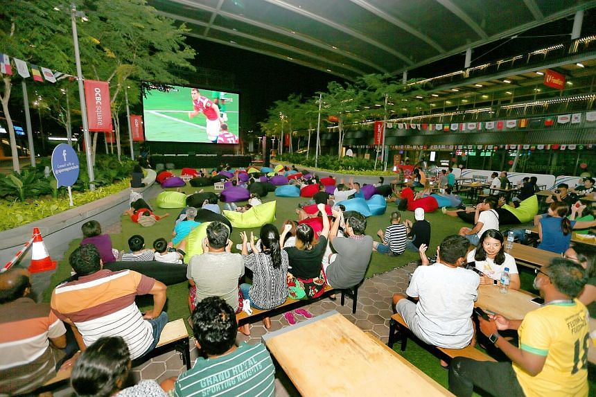 A live telecast of a World Cup match in June at the Sports Hub. Last week, however, soccer fans were left on the edge of their seats while waiting to see if Singtel and StarHub would beam the Champions League and Europa League group stages live.