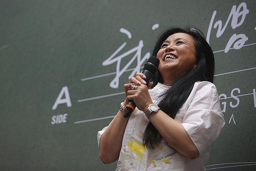 Singer Dawn Gan's xinyao hits include Water Tales and Your Reflection, and she won fans with her bright voice and personality.