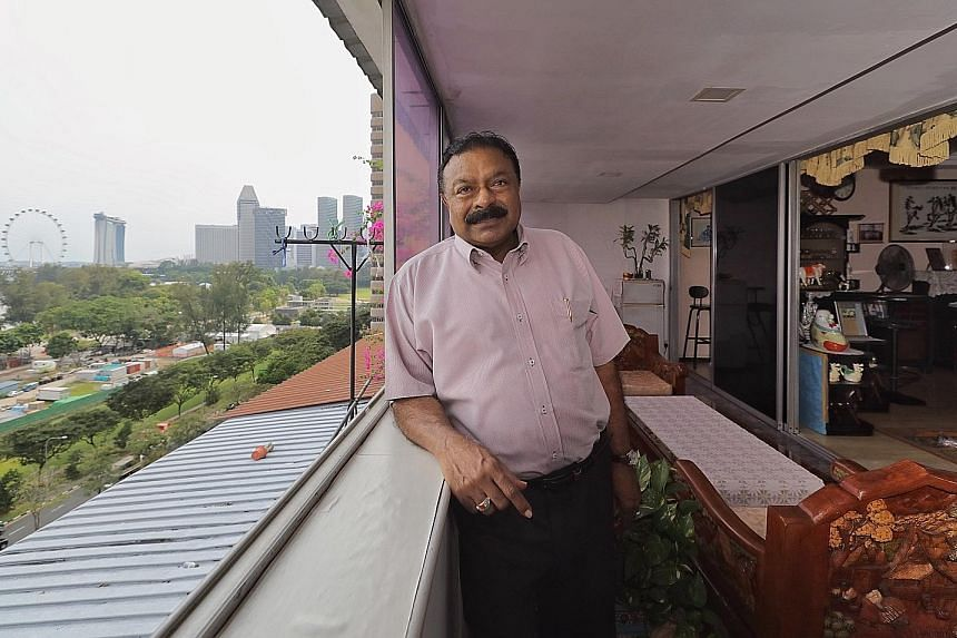 Above: Mr Ponno Kalastree, 71, says his apartment at Golden Mile Complex is a good spot to enjoy fireworks and the light shows of the Supertrees at Gardens by the Bay. Below: The stepped terrace building was originally meant to herald a new era for t