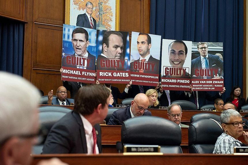 Posters of those who have pleaded guilty to charges stemming from the Mueller investigation into Russian meddling in the 2016 US presidential election being displayed during a House committee hearing on Capitol Hill in Washington on July 12 this year