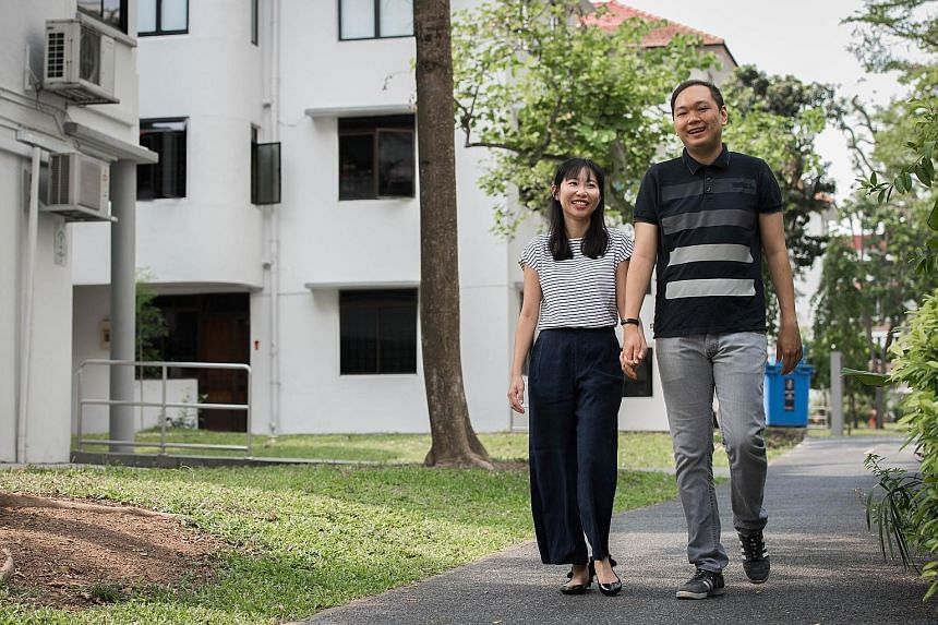 Left: Mr Illyas Lim-Effandi and his wife, Ms Michelle Ng, near their walk-up SIT flat in Tiong Bahru estate. Above: Mr Eric Ho and his wife, Ms See Kwee Hua, with their baby, Hana, in their Holland Drive flat, which has less than 55 years' lease left