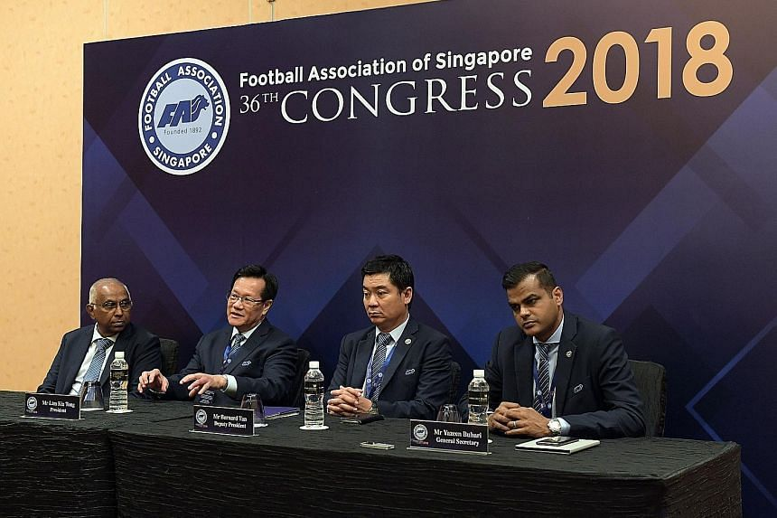 Football Association of Singapore executive committee members (from left) S. Thavaneson, Lim Kia Tong, Bernard Tan and Yazeen Buhari taking questions at a media conference for local football's annual congress at the Marina Bay Sands Convention Centre