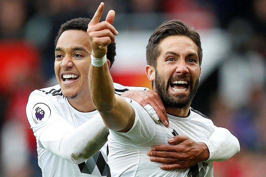 Joao Moutinho celebrating his 53rd-minute goal against Manchester United with Helder Costa yesterday. Wolverhampton Wanderers had looked nothing like a promoted team, playing confident and composed football and were rewarded with the fine team goal.