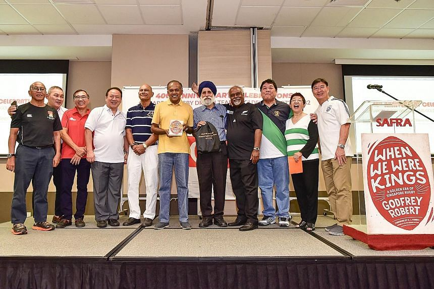 Home Affairs & Law Minister K. Shanmugam with a copy of When We Were Kings at yesterday's launch. Others are (from left) Sumardi Sarkawi, Song Koon Poh, Shee Lay Toon, Tay Huai Eng, Natahar Bava, Jarmal Singh, Godfrey Robert, Alfred Lee, Rose Bava an