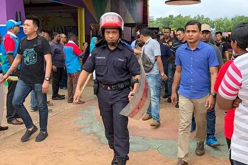 Glitches led to the postponement of voting in eight out of 15 branch elections in Kedah. Slow-moving and long queues added to the tension, and four suspects are being investigated for a rioting incident which left a man with minor head injuries.