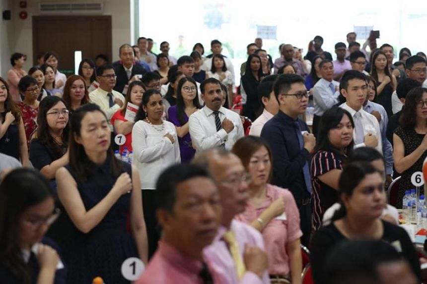 150 new citizens from Ang Mo Kio GRC and Sengkang West SMC received their citizenship certificates at a citizenship ceremony, on Sept 23, 2018.