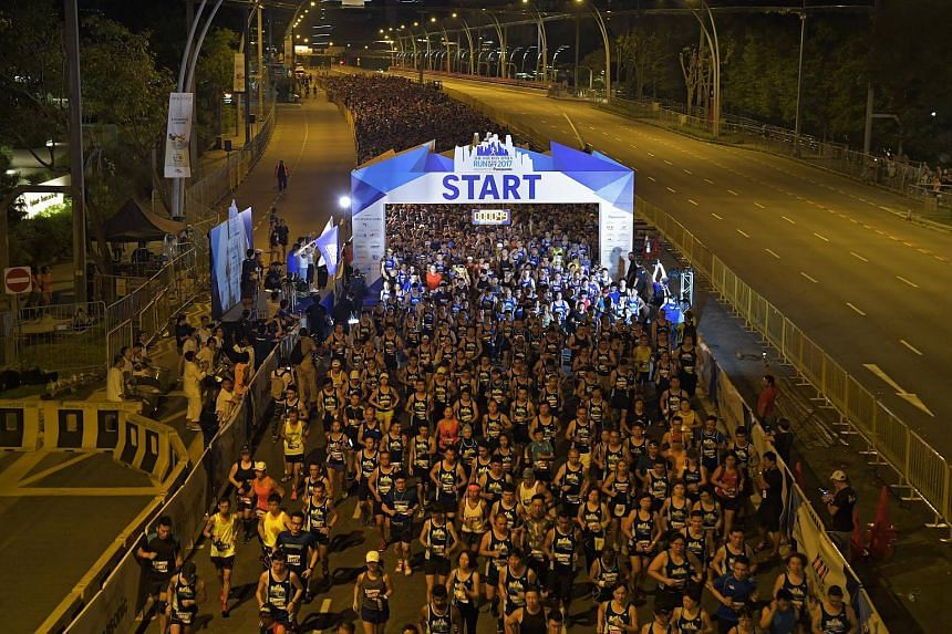 File photo of runners of the 18.45km race of the ST Run at the flag-off on the Esplanade Bridge, on July 16, 2017.