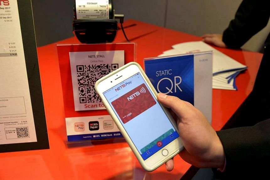 """Nets said that its QR code system had encountered an """"unexpected scenario"""" that prevented some payment requests from being completed."""