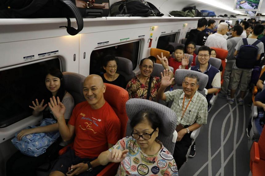 Passengers of the first train departing from Hong Kong during the first day of service of the Hong Kong Section of the Guangzhou-Shenzhen-Hong Kong Express Rail Link, on Sept 23, 2018.