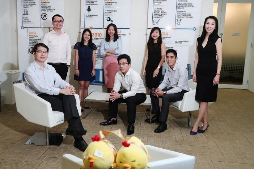 The team from the Competition and Consumer Commission of Singapore that investigated the chicken price-fixing case: (from left) team leader Kong Weng Loong, Mr Lim Wei Lu, Ms Sarah Tan, Ms Ethel Lin, Mr Tham Chang Xian, Ms Janet Chua, Mr Nicholas Sim