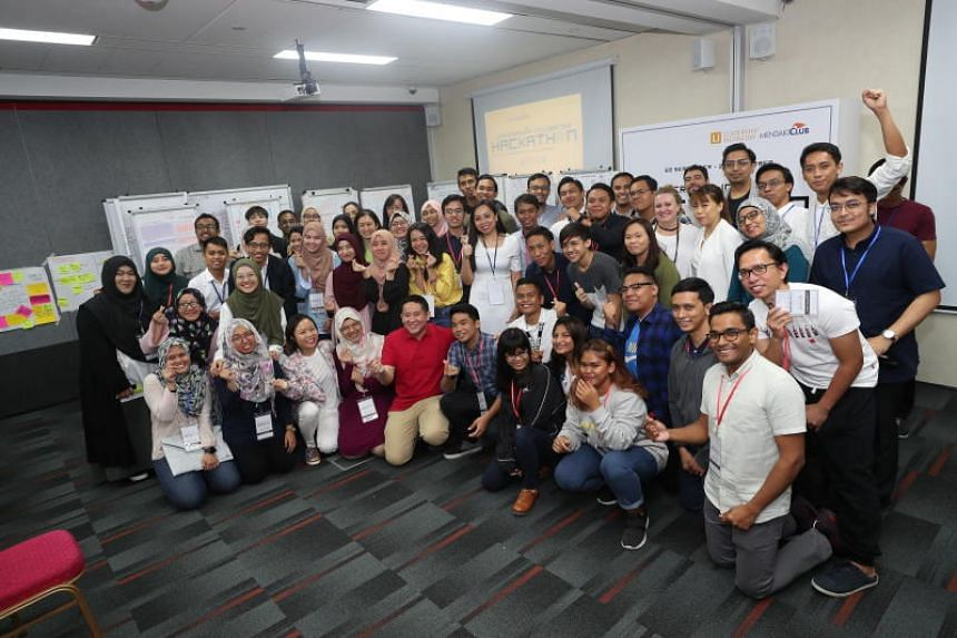 Senior Parliamentary Secretary for Home Affairs and Health Amrin Amin (front row, fifth from left) with participants of a 30-hour hackathon organised by Mendaki Club.