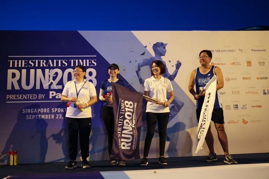 On stage to flag off the 10km category of the ST Run: (from left) ST eports editor Lee Yulin, ST executive editor Sumiko Tan, general manager of Panasonic Singapore's marketing communications department Joanne Ng, and SPH CEO Ng Yat Chung.