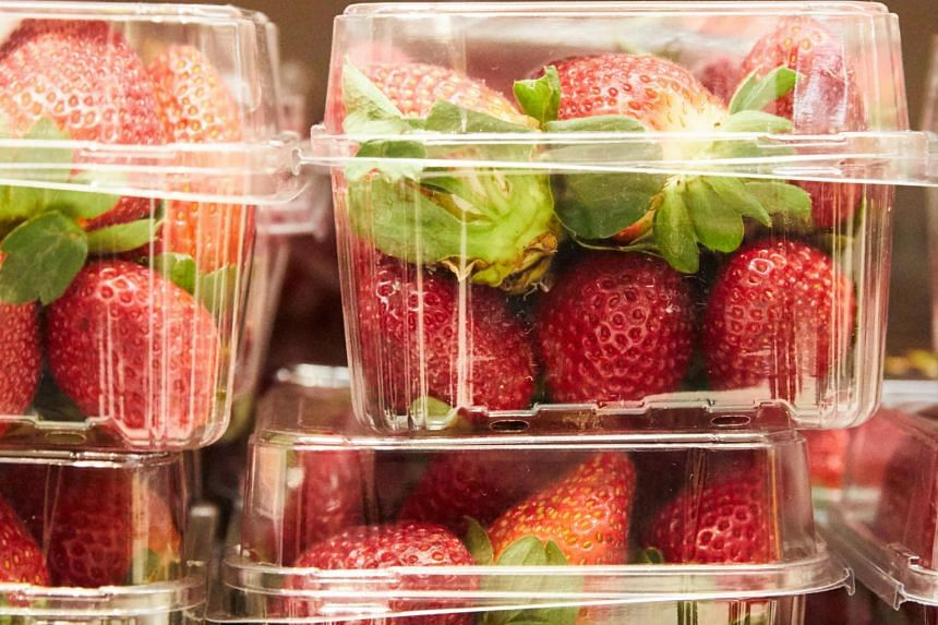 Strawberry punnets seen at a supermarket in Sydney, on Sept 13, 2018. In Australia, more than 100 alleged incidents of pins and needles found in fruit have been reported since the scare began in Queensland state earlier this month.