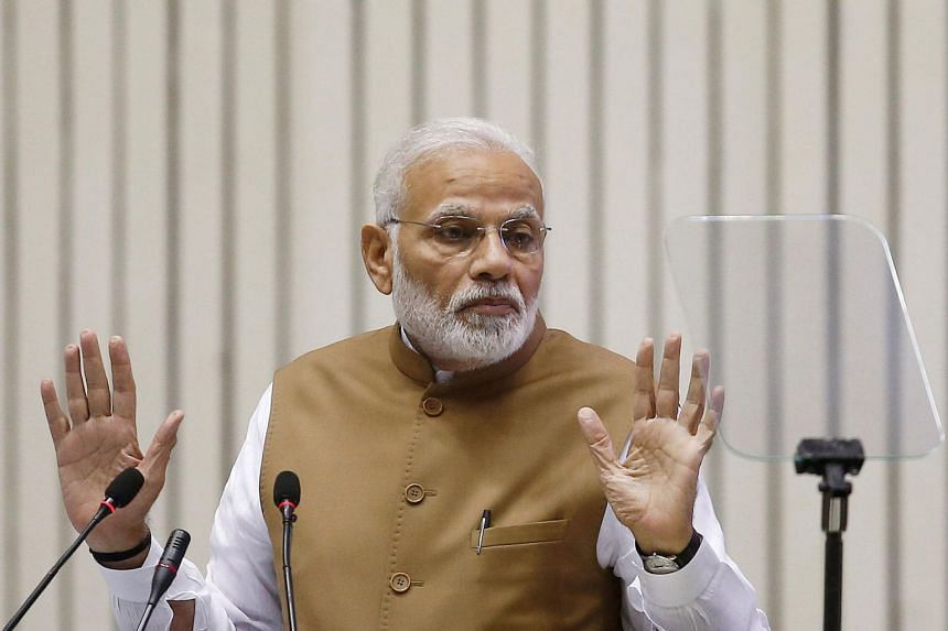 India's Prime Minister Narendra Modi gestures as he addresses the gathering during the Global Mobility Summit in New Delhi on Sept 7, 2018.