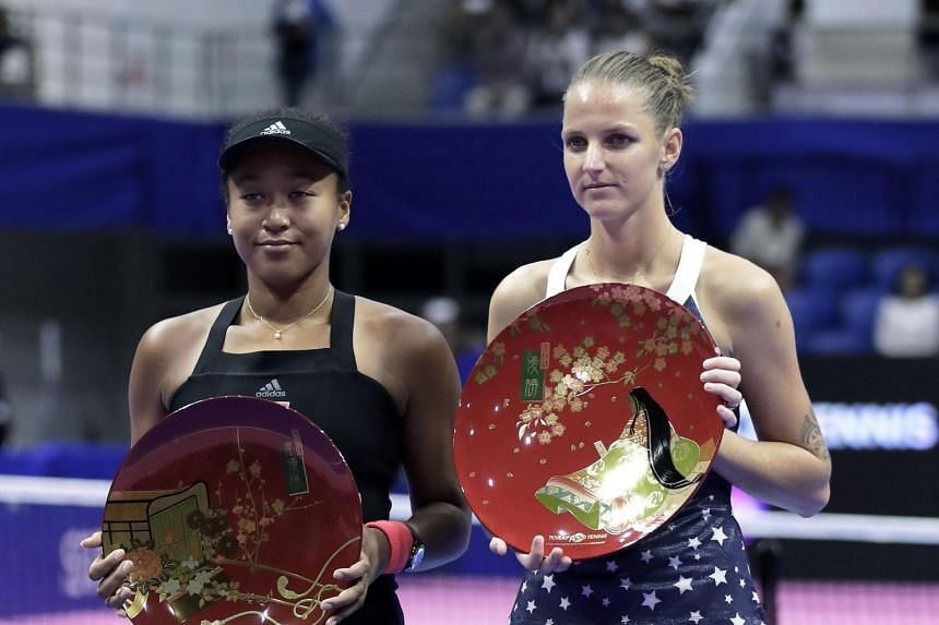 (From left) Naomi Osaka and Karolina Pliskova receiving their trophies after the Pan Pacific Open women's tennis tournament in Tachikawa, Japan, on Sept 23, 2018.