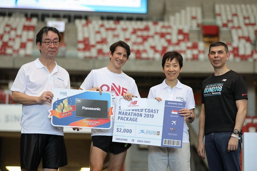 (From left) Panasonic deputy managing director Jiro Nakami; the 18.45km men's category winner Ben Moreau; Minister for Culture, Community and Youth Grace Fu; and Singapore Press Holdings' English/Malay/Tamil Media Group Editor-in-Chief Warren Ferna