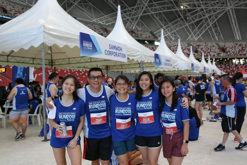 Samwoh Corporation CEO Eric Soh (second from left) and his family at the sixth edition of the Straits Times Run on Sept 23, 2018.
