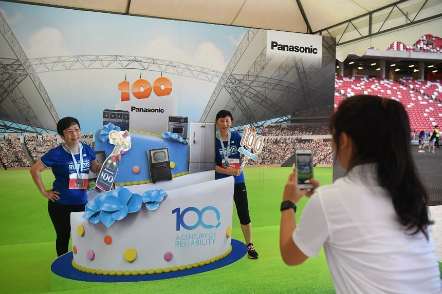 Ms Soh Bee Leng (left), 56, and Ms Catherine Chua, 69, taking a photo at the Panasonic booth after their 5km run.
