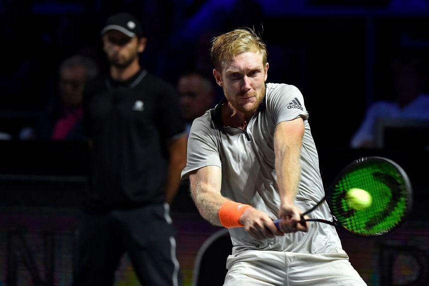 Bachinger returns a ball to Japanese tennis player Kei Nishikori.