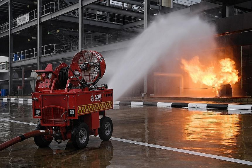 One of the new technologies being explored by the Singapore Civil Defence Force is the Pumper Firefighting Machine, a remotely controlled device that can get close to fires without risking the lives of firefighters.