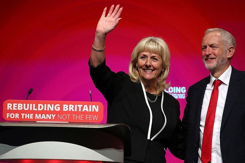 Labour general secretary Jennie Formby and party leader Jeremy Corbyn at the party conference in Liverpool yesterday. The party is split over Brexit and Mr Corbyn is trying to balance the debate to prevent alienating voters he would need to win an el