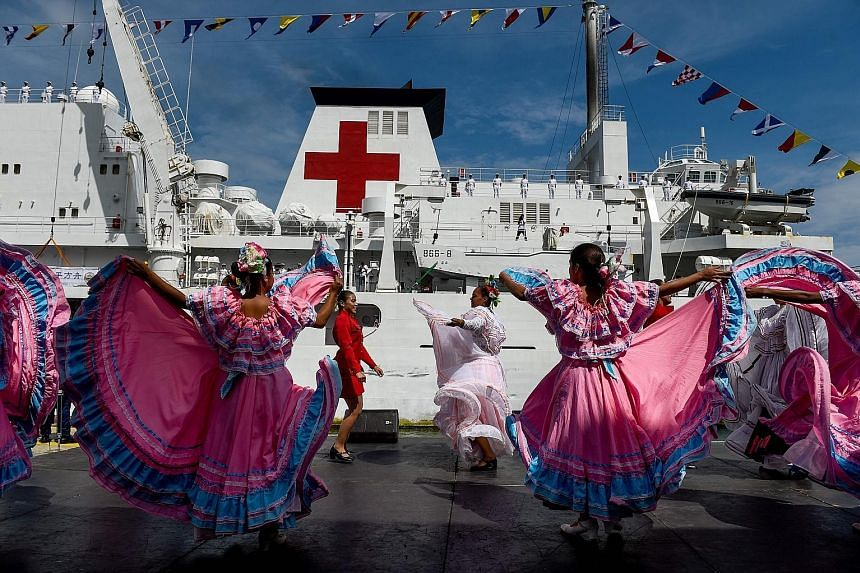 """Venezuelan dancers welcoming Chinese naval medical ship """"Peace Ark"""" at the La Guaira port on Saturday. During the vessel's eight-day stay, its commander would visit military and political officials and inspect Venezuelan military and medical faciliti"""