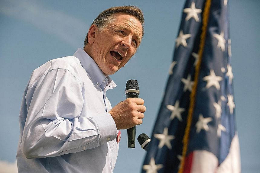 Republican Paul Gosar (left) is expected to retain his seat despite a series of ads by his Democrat opponent, Mr David Brill, featuring six of the congressman's nine siblings.