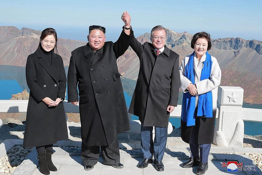 North Korean leader Kim Jong Un (second from left) and his wife Ri Sol Ju (left) with South Korean President Moon Jae-in and his wife Kim Jung-sook on the top of the sacred Mount Baekdu on Sept 20 after their summit in Pyongyang.