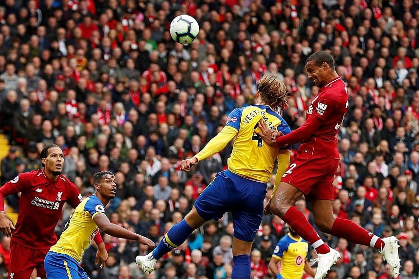 Liverpool's Joel Matip rises to nod in their second goal against Southampton. It followed Xherdan Shaqiri's shot which hit Shane Long before going in off Wesley Hoedt for an own goal - the opener in the Premier League leaders' 3-0 home win on Saturday.