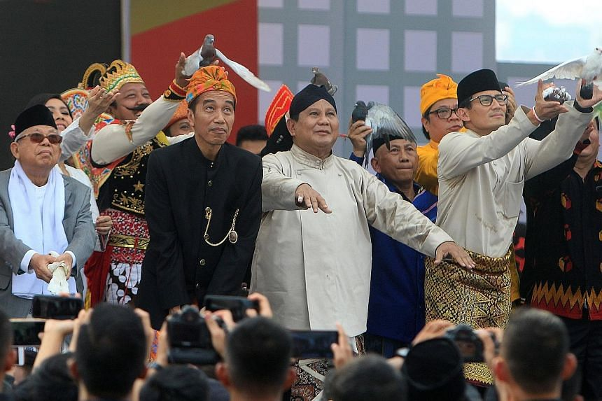 (From far left) Mr Ma'ruf Amin; Indonesian President Joko Widodo; his main rival, Mr Prabowo Subianto; and Mr Sandiaga Uno yesterday releasing birds as a symbol of peace during a ceremony to mark the start of campaigning for the presidential election