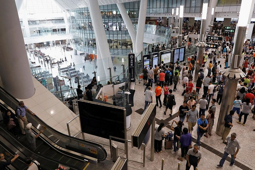West Kowloon station packed with people on the first day of the express rail service. The project has generated some controversy as mainland officers have almost full jurisdiction over a 105,000 sq m area designated as a mainland port zone in the ter
