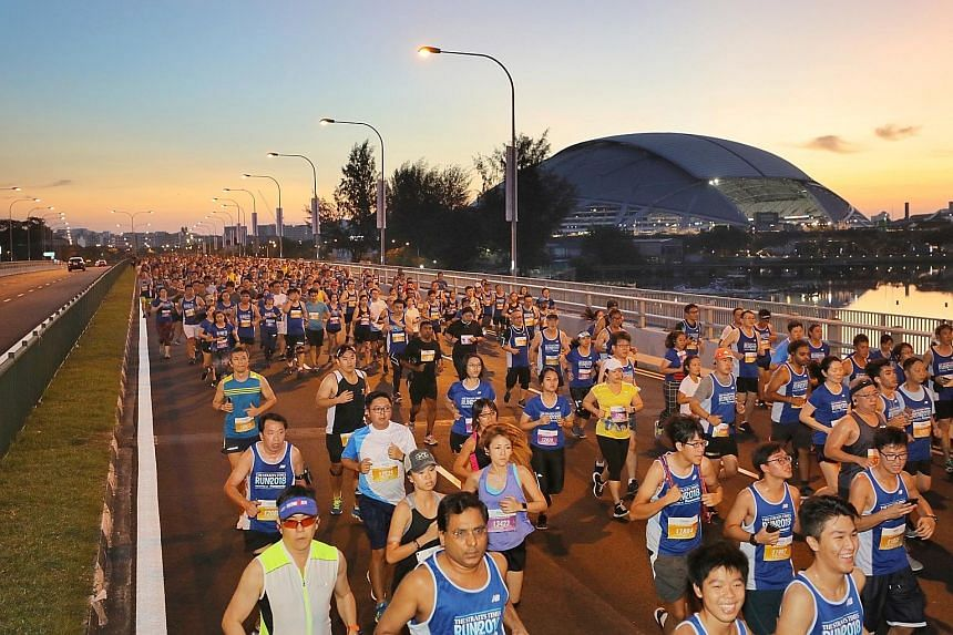 ST Run participants taking part in the 10km race on Merdeka Bridge yesterday. This year, all three races - the 18.45km, 10km and 5km - finished at the National Stadium, where participants enjoyed a festival atmosphere and had the chance to win prizes