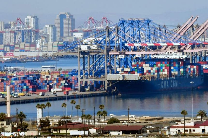 File photo of containers being loaded onto shipping vessels at the Port of Long Beach in Long Beach, California.