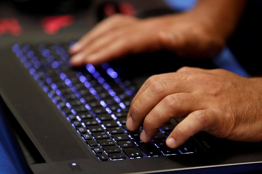 File photo showing a man typing into a keyboard during a hacker convention in Las Vegas, Nevada, on July 29, 2017.