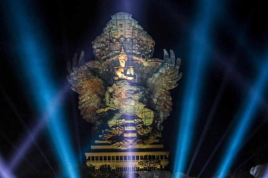 Artificial light illuminates the Garuda Wisnu Kencana statue during the inauguration ceremony in Ungasan, Bali, on Sept 22, 2018.