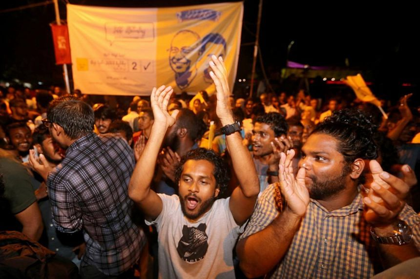 Supporters of Maldivian opposition leader Ibrahim Mohamed Solih celebrate in Male, on Sept 24, 2018.