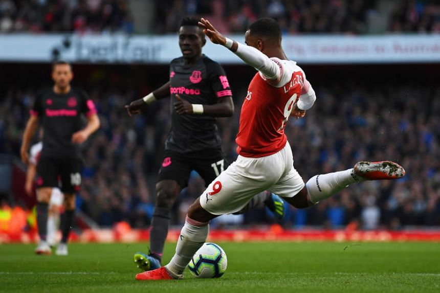 Arsenal's Alexandre Lacazette (right) scores the 1-0 lead during the English Premier League soccer match between Arsenal FC and Everton FC in London, Britain, on Sept 23, 2018.