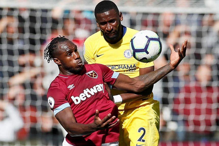 West Ham's Michail Antonio in action with Chelsea's Antonio Rudiger.