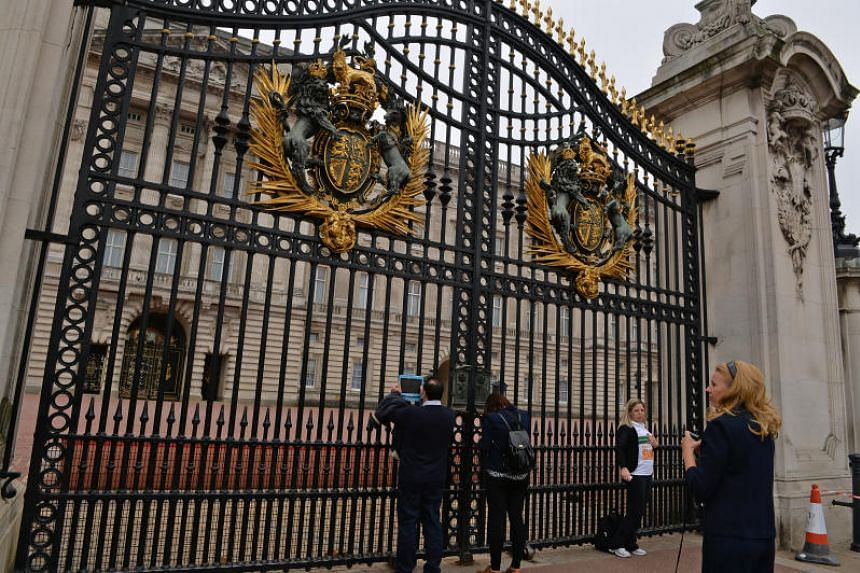 Tourists at the front gate of the Buckingham Palace in London on Sept 11, 2014.