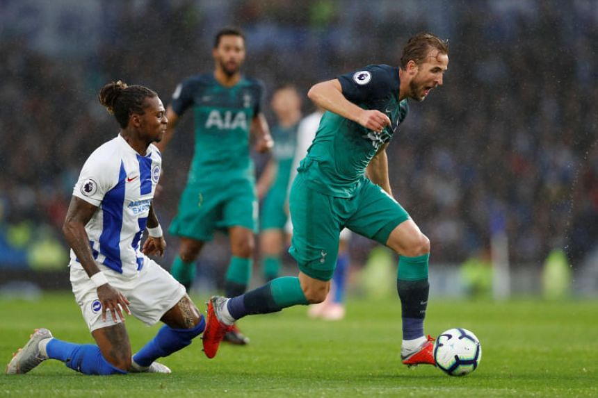 Tottenham Hotspur's Harry Kane (right) in action during the English Premier League match against Brighton & Hove Albion at The American Express Community Stadium in Brighton on Sept 22, 2018.