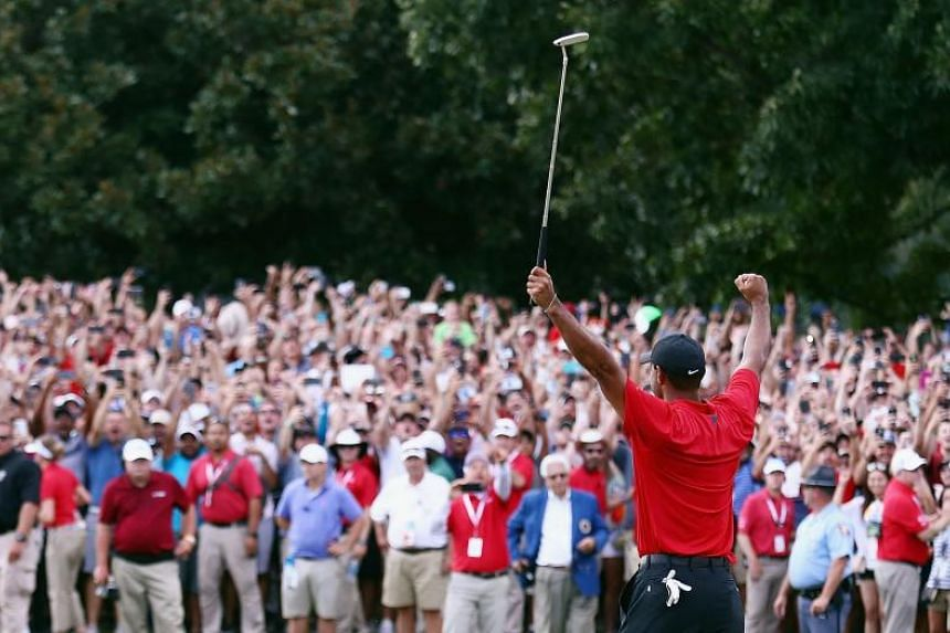 Tiger Woods celebrates making a par on the 18th green to win the Tour Championship in Atlanta, Georgia, on Sept 23, 2018.