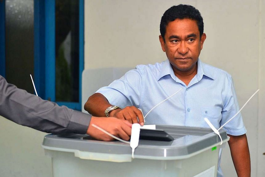 President Abdulla Yameen casting his vote yesterday. The 59-year-old is seeking a second five-year term.