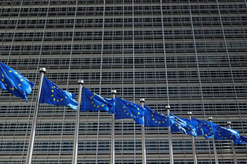 European Union flags flutter outside the EU Commission headquarters in Brussels on June 20, 2018.