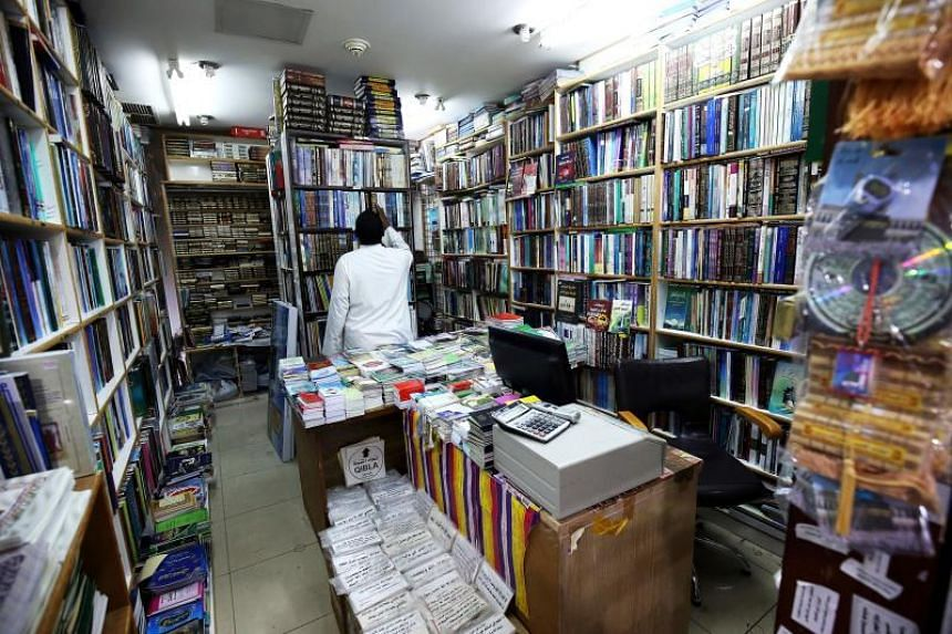 A vendor organises books at a bookstore in Kuwait City on Sept 17, 2018. More than 4,000 books have been blacklisted by Kuwait's information ministry over the past five years, according to local reports.